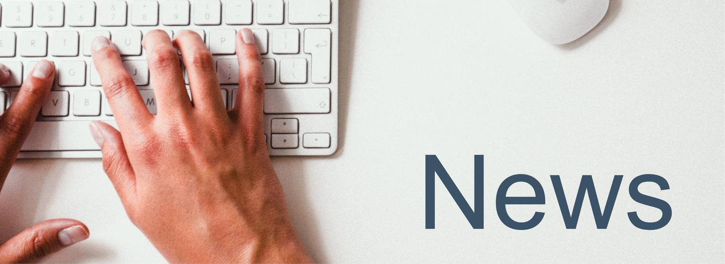 "Hands typing on a keyboard, the word ""news"" is displayed."